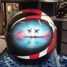 puerto rican flag visual with coastline scene onmotorcycle helmet